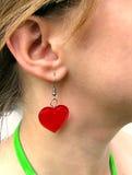 Boucle d'oreille s'usante de coeur de Madame Images libres de droits