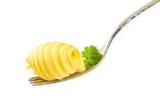 Boucle de beurre sur la fourchette Photographie stock