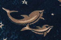 Boucle fabric with drawing of dolphins Royalty Free Stock Images