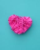 Boucle rose dans la forme du coeur (concept d'amour) Image libre de droits