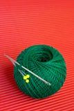 Boucle verte sur le rouge Photographie stock