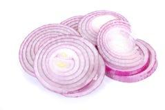 Boucles d'oignon rouge coupées en tranches Photographie stock libre de droits
