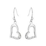 Boucles d'oreille argentées sous forme de coeur Image stock