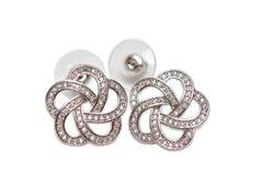 Boucles d'oreille avec des diamants photographie stock libre de droits