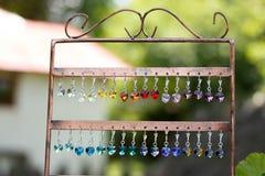 Boucles d'oreille colorées Photos stock