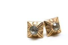 Boucles d'oreille d'or Images libres de droits
