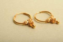 Boucles d'oreille d'or Image libre de droits