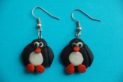 Boucles d'oreille de pingouin Photos stock