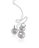 Boucles d'oreille et collier argentés de diamant Images stock