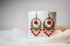 Boucles d'oreille rouges Photographie stock libre de droits