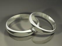 Boucles de mariage argenté Images libres de droits