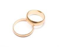 Boucles de mariage sur le blanc Images libres de droits