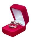 Boucles de mariage sur le fond d'isolement Photo libre de droits