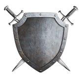 Bouclier âgé en métal avec les épées croisées d'isolement Image libre de droits