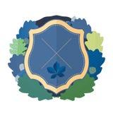 Bouclier bleu avec une guirlande Images stock