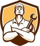Bouclier d'Arms Crossed Wrench de mécanicien rétro Image stock