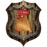 Bouclier en bois rond avec la tête d'un coq Image libre de droits