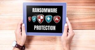 Boucliers de protection de Ransomware sur le comprimé Photographie stock libre de droits