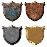 4 boucliers en métal Photographie stock libre de droits