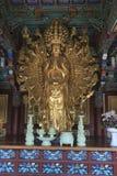 Or Bouddha armé multi Photo stock