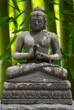 Bouddha avec le bambou Photographie stock libre de droits
