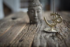 Bouddha and censer. Bouddha on a wwoden table made out of old barn wood. Censer Royalty Free Stock Photo