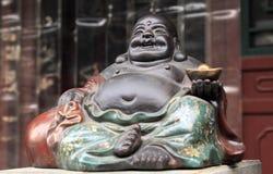Bouddha du visage de sourire. photographie stock libre de droits