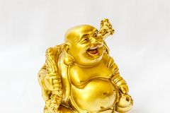 Bouddha riant peint dans la couleur d'or avec le contexte blanc Photo libre de droits