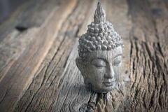 Bouddha. On a rustik table Royalty Free Stock Images