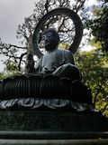 Bouddha in the japanese garden of the golden gate park, san francisco. Statue of bouddha in san francisco Royalty Free Stock Photo