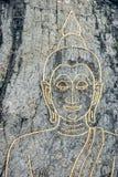 Bouddha sur le mur en pierre Photos stock