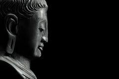 Bouddha sur le noir Photos libres de droits