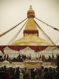 Boudhanath. The Buddhist stupa of Boudhanath dominates the skyline. The ancient Stupa is one of the largest in the world. The influx of large populations of Royalty Free Stock Images