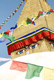 Boudhanath Stupa. Closeup of the Buddha eyes of Boudhanath stupa surrounded by prayer flags in Kathmandu, Nepal. It is the largest stupa in Nepal and the holiest Royalty Free Stock Photos