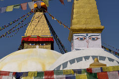 Boudhanath Stupa. Golden spire and all seeing Buddha eyes on top Royalty Free Stock Images