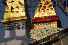 Boudhanath Stupa. Golden spire and all seeing Buddha eyes on top Stock Images