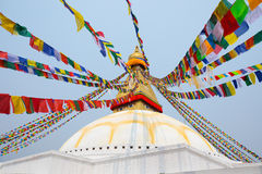 Boudhanath stupa and its colorful flags in daylight. Stock Photos