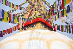 Boudhanath stupa and its colorful flags in daylight. Royalty Free Stock Photography