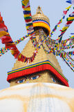 Boudhanath stupa and its colorful flags in daylight. Stock Photography