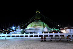 Boudhanath stupa at night, Kathmandu, Nepal. BOUDHANATH - OCTOBER 8: The biggest Buddhist stupa of Boudhanath in the World, destroyed only partially after the Stock Image