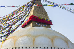 Boudhanath stupa - the symbol of Nepal, with colorful prayer flags in the background. Travel. Royalty Free Stock Image