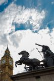 Boudiccan Rebellion monument with Big Ben, Westminster, London. Low, wide angle perspective. Shoot in sunny summer day. London, UK, 9 July 2017 Stock Photo