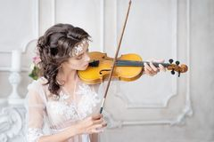 Woman with violin in white peignoir. Boudoir. seductive. Boudoir of bride, in room, morning. Woman with violin in white peignoir. Boudoir. seductive stock photography