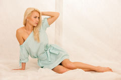 Boudoir photos of a beautiful blond woman in night dress Royalty Free Stock Image