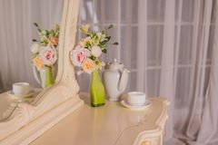 Boudoir table. Details of the interior of the bedroom for girls and make-up, hairstyles with a mirror. Good morning royalty free stock photo