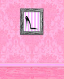 Boudoir Wall of Pink Damask. Pink damask room with framed picture of a high-heeled shoe Royalty Free Stock Photos