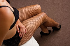 Boudoir woman put on shoes on bed Royalty Free Stock Photo