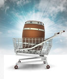 Bought beverage barrel in shopping cart with sky Royalty Free Stock Photos
