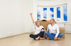 Bought a new flat. A man and a woman are happy with their new flat royalty free stock photo