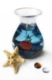 Bougie de gel, étoiles de mer et deux décorations en verre Photographie stock libre de droits